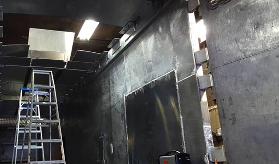 The inside of a trailer being repaired